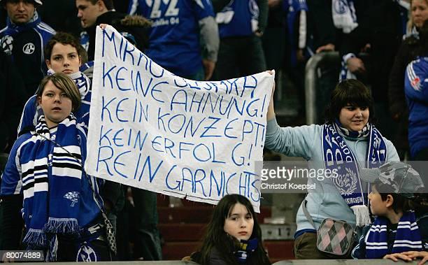 The fans of Schalke show a banner against head coach Mirko Slomka after loosing 01 the Bundesliga match between Schalke 04 and Bayern Munich at the...