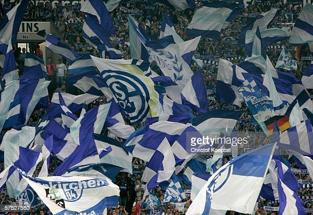The fans of Schalke wave the flags before the Bundesliga match between Schalke 04 and Arminia Bielefeld at the Veltins Arena on May 3 2006 in...