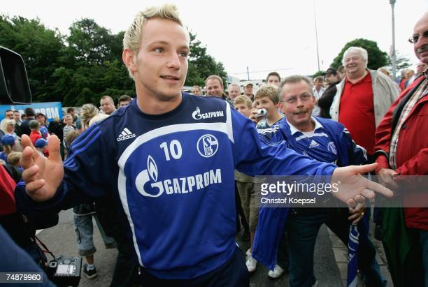 The fans of Schalke welcome the new player Ivan Rakitic before the training session of FC Schalke 04 at their training ground on June 25 in...