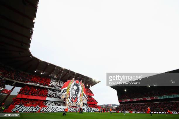 The fans of Standard Liege hold up large flags and signs with Ultras Inferno as well as the devil team logo during the Belgian Jupiler Pro League...