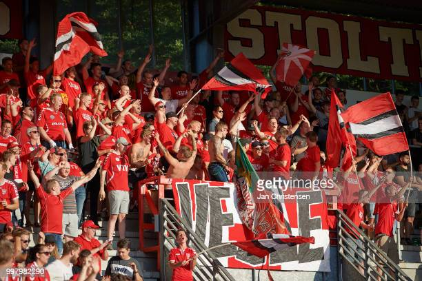 The fans of Vejle Boldklub celebrate after the Danish Superliga match between Vejle Boldklub and Hobro IK at Vejle Stadion on July 13 2018 in Vejle...