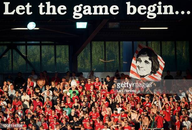The fans of Vejle Boldklub cheer with a banner with a photo of Allan Simonsen during the Danish Superliga match between Vejle Boldklub and AGF Aarhus...