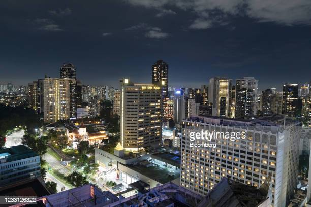 The Far East Plaza, center left, and the Grand Hyatt hotel, right, on Scotts Road in the Orchard Road area of Singapore, on Saturday, May 8, 2021. As...