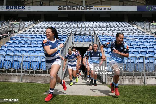 The Farah Palmer Cup teams head out onto the field during the round 2 Farah Palmer Cup match between Northland and Auckland at Semenoff Stadium on...