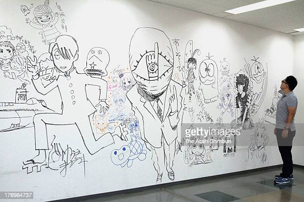 The farewell graffiti of popular manga characters drawn by 25 manga artists attracts crowds at the headquarter building of a manga publisher...