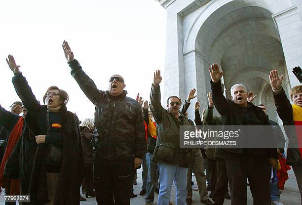 The fascist salute is given by supporters of late Spanish dictator Francisco Franco 17 November 2007 outside the basilica of Santa Cruz at the Valley...