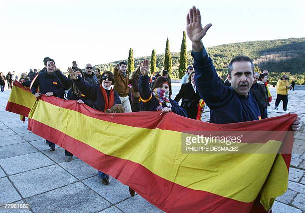 The fascist salute is given by supporters of Spanish dictator Francisco Franco 17 November 2007 outside the basilica of Santa Cruz at the Valley of...