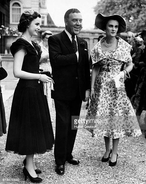 The fashion designer and Royal dressmaker Norman Hartnell with the Duchess of Argyll and her daughter Frances Sweeney at a cocktail party for...