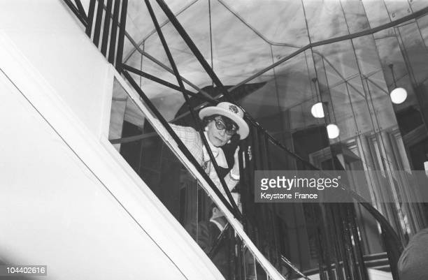 The fashion designer Coco CHANEL monitored her fashion show from the staircase.
