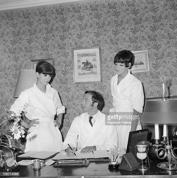 The Fashion Designer Marc Bohan Explaining His Ideas To Two TopModels Prunella And Christelle During The Preparations For The Christian Dior Winter...