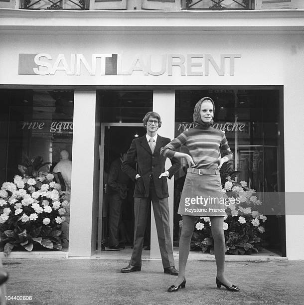 The fashion designer Yves SAINT LAURENT and the Swedish model ULLA wearing one of his creations standing before his RIVE GAUCHE boutique in Paris