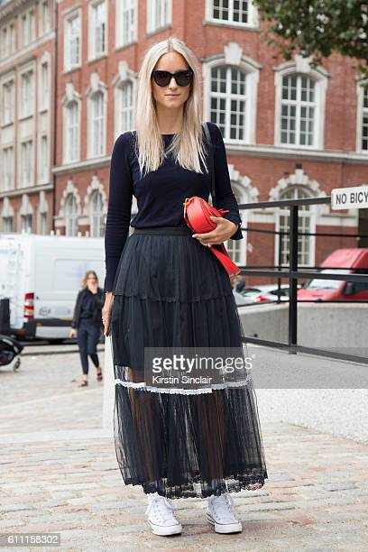 The Fashion Guitar Editor Charlotte Groeneveld wears Zara top Preen skirt Converse shoes Anya Hindmarch bag and Celine glasses on day 3 of London...