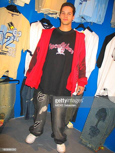 The fashion of 'baggy pant' or jeans sizes XXL and up a young posing in a shop wearing long pants a sweatshirt and a jacket large