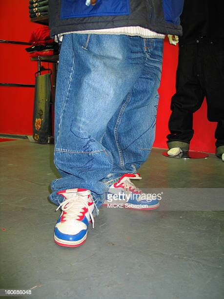 The fashion of 'baggy pant' or jeans sizes XXL and up closeup on the bottom of a'' very low down surtaille jeans below the waist