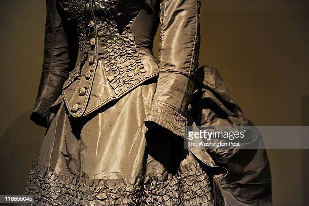 The fashion of the 1870's is reflected in the large bustle skirt of Ella Merriweather's wedding gown worn during her marriage to Charles Post in 1874...