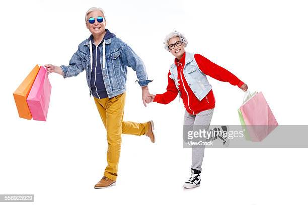 The fashion of the elderly with shopping bags