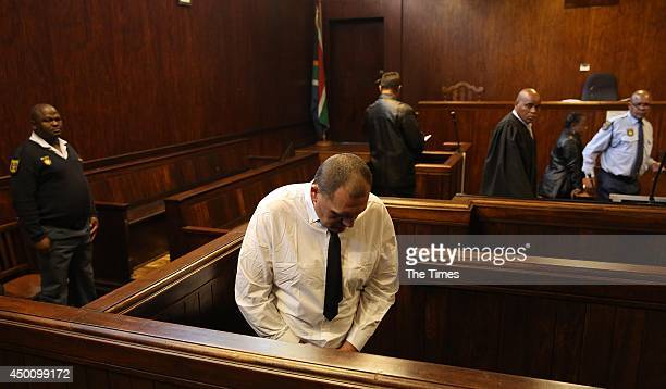 The father accused of holding his wife and children captive appears for his bail hearing at the Springs Magistrate's court on June 4 2014 in Springs...