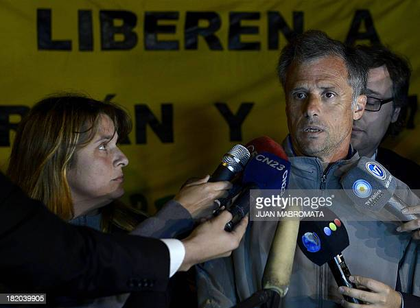 The father and mother of Argentine Greenpeace activist Camila speak with press during a protest on September 27 2013 in front of the Russian embassy...