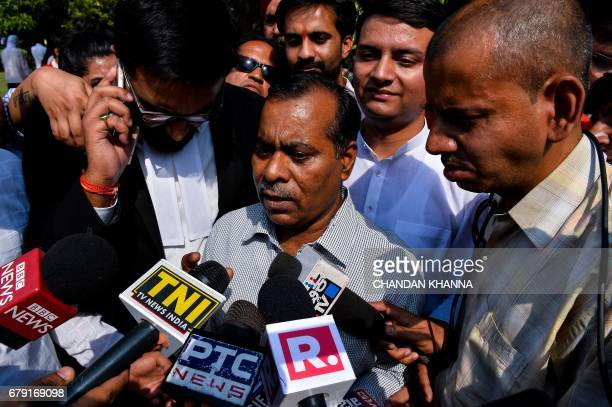 The father of Indian gangrape victim 'Nirbhaya' addresses media representatives as he leaves The Supreme Court in New Delhi on May 5 2017 India's...