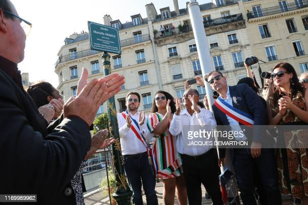The father of slain Brazilian councilwoman Marielle Franco Antonio da Silva claps as he stands with other family members and French officials during...