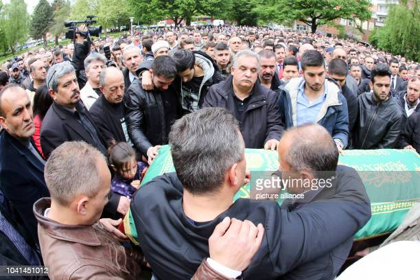 The father relatives and friends stand at the coffin of Diren Dede during a funeral in Hamburg Germany 04 May 2014 Diren was an exchange student in...