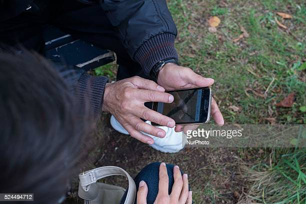 The father shows the cellular pathway made from Syria to arrive in Germany Munich September 20 2015 The bayernkaserne is a reception center in Munich...
