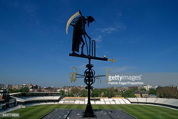 The Father Time weather vane in its new position with the new Grand Stand under construction in the background at Lord's Cricket Ground London circa...