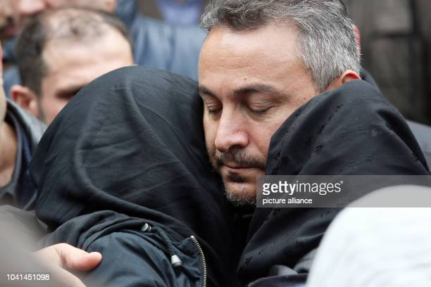The father of Diren Dede during a funeral in Hamburg Germany 04 May 2014 Diren was an exchange student in Missoula Montana USA and was shot there...