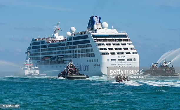 TOPSHOT The Fathom cruise ship Adonia departs Miami Beach Florida with fanfare and water cannons on her inaugural sevenday voyage to Cuba on May 1...