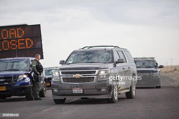 The FBI and Oregon State Police vehicles race past a road block leaving the Malheur Wildlife Refuge Headquarters near Burns Oregon on February 11...