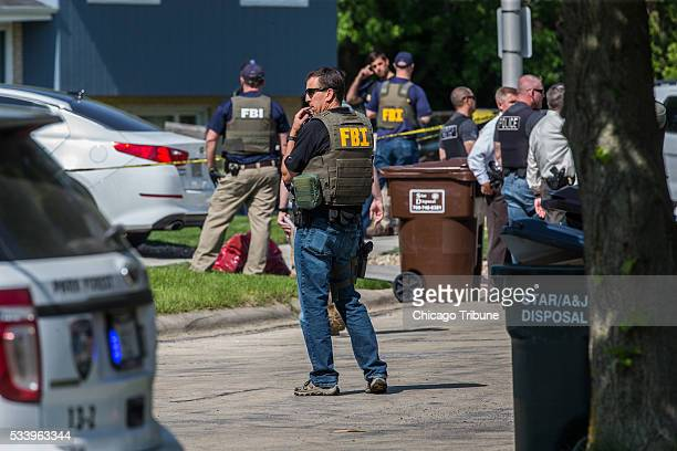 The FBI investigate a shooting at 5 Rich Ct on Tuesday May 24 2016 in Park Forest Ill