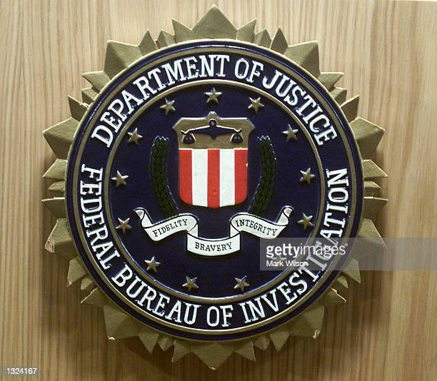 The FBI seal is on display during a conference with Attorney General John Ashcroft June 21 2001 in Washington DC Ashcroft announced the indictments...