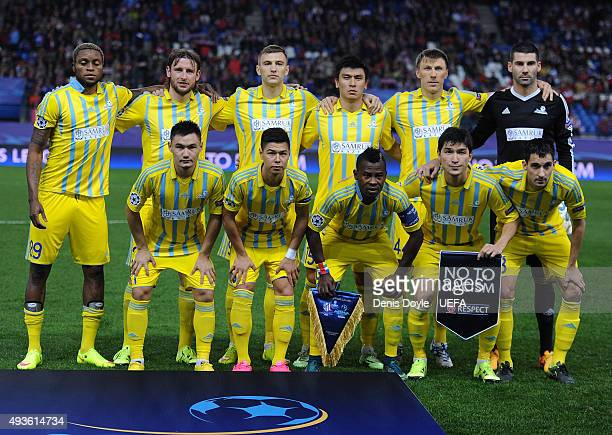 The FC Astana team pose for a team photograph holding the ''No to Racism'' pennant during the UEFA Champions League Group C match between Club...