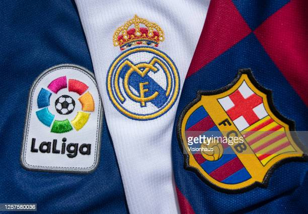 The FC Barcelona and Real Madrid club crests on the first team home shirts witht the La Liga logo on July 22 2020 in Manchester United Kingdom