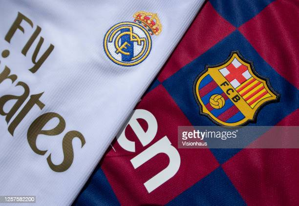 The FC Barcelona and Real Madrid club crests on the first team home shirts on July 22 2020 in Manchester United Kingdom