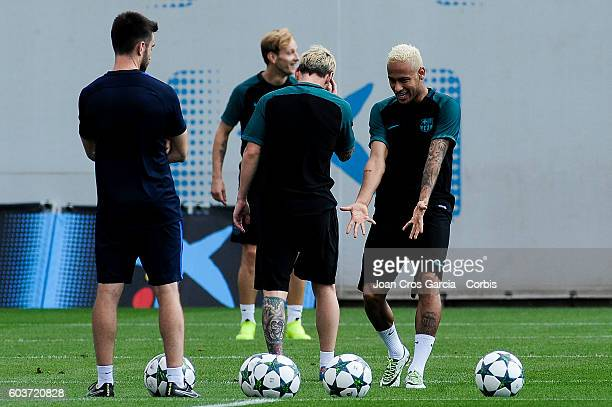 The FC Barcelona forwards Lionel Messi and Neymar Jr jogging during the training session at the Sports Center FC Barcelona Joan Gamper before the...
