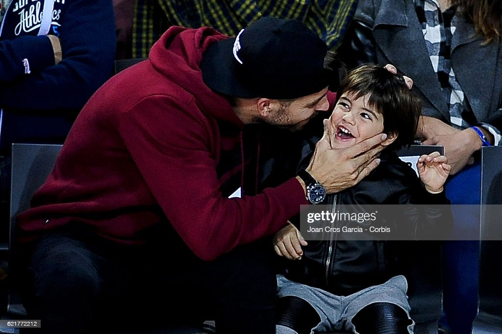 The F.C Barcelona player, Gerard Piqué and his son Milan Piqué, attending the basketball Spanish Endesa League match between F.C Barcelona Lassa and Real Madrid, on November 6, 2016 in Barcelona, Spain.
