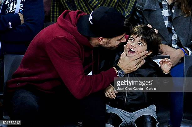 The FC Barcelona player Gerard Piqué and his son Milan Piqué attending the basketball Spanish Endesa League match between FC Barcelona Lassa and Real...