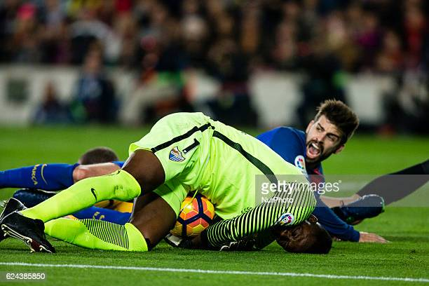 The FC Barcelona player Gerard Pique from Spain against The Malaga CF goalkeeper Carlos Kameni from Camerun during the La Liga match between FC...
