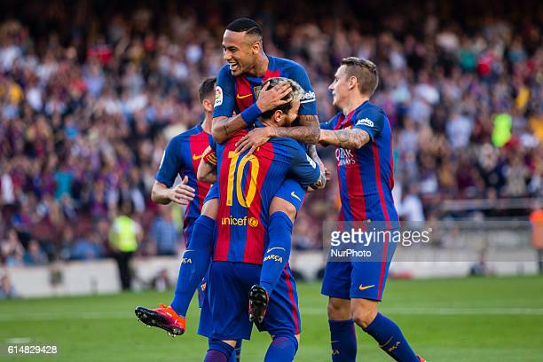 The FC Barcelona player Lionel Messi from Argentina celebrating his first goal of the match with Neymar from Brasil during the La Liga match between...
