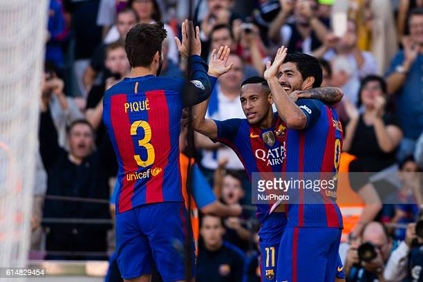 The FC Barcelona player Luis Suarez from Uruguay celebrating the third goal of the match with Gerard Pique from Spain and Neymar from Brasil during...