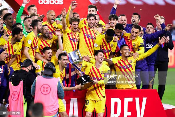 The FC Barcelona team celebrate with the trophy at the end of the Copa del Rey Final match between Athletic Club and Barcelona at Estadio de La...