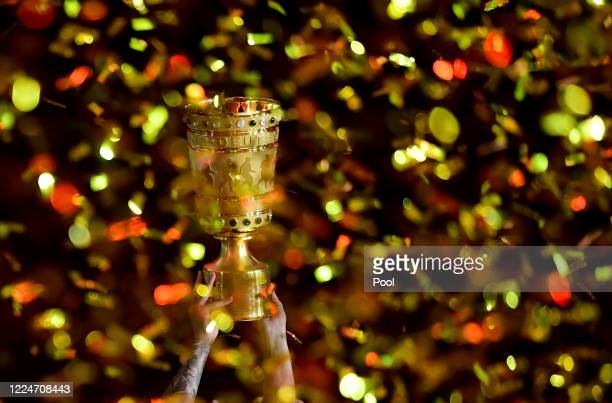 The FC Bayern Muenchen players lift the trophy after winning the DFB Cup final match between Bayer 04 Leverkusen and FC Bayern Muenchen at...