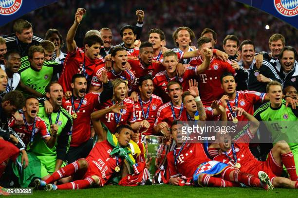 The FC Bayern Muenchen team poses with the trophy after winning the UEFA Champions League final match against Borussia Dortmund at Wembley Stadium on...