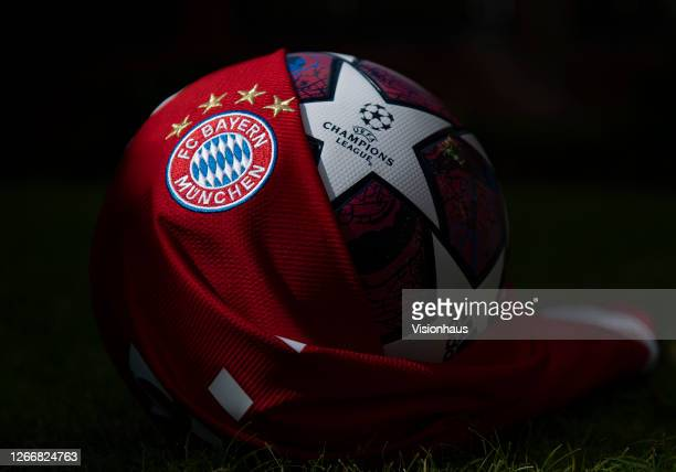 The FC Bayern Munich club crest on their home shirt with the Starball the official adidas UEFA Champions League match ball on August 17 2020 in...