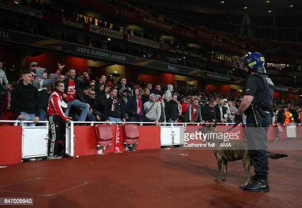 The FC Koln fans taunt the police dog and it's handler before the UEFA Europa League group H match between Arsenal FC and 1 FC Koeln at Emirates...