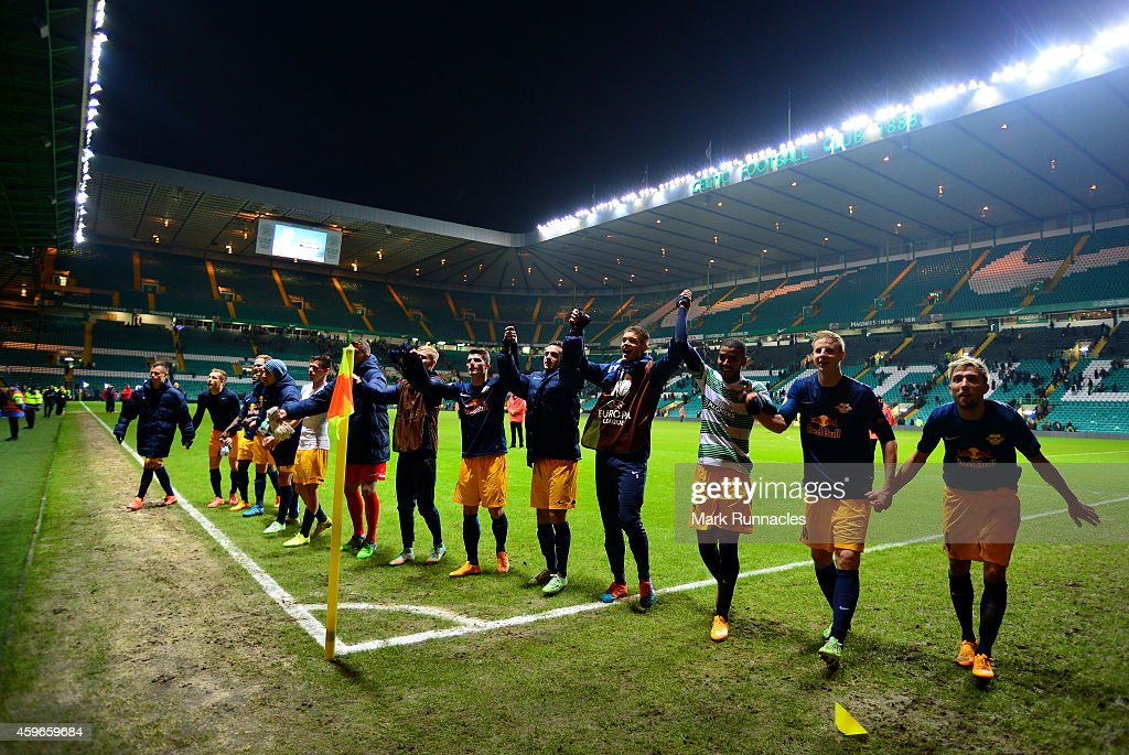 The FC Salzburg team celebrates in front of their fans after the final whistle during the UEFA Europa League group D match between Celtic FC and FC Salzburg at Celtic Park on November 27, 2014 in Glasgow Scotland.