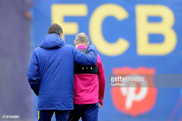 The FCBarcelona coach Luis Enrique and the player Andres Iniesta speaking during the FC Barcelona training session in Barcelona 8 of April 2016