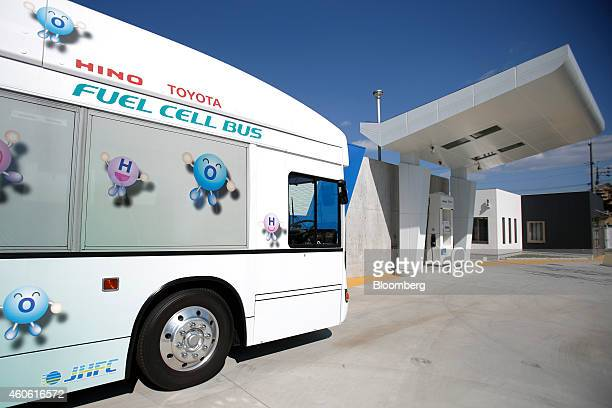 The FCHVBUS fuelcell hybrid bus jointly developed by Toyota Motor Corp and Hino Motors Ltd sits parked at a hydrogen station operated by Toho Gas Co...