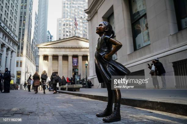 The 'Fearless Girl' statue stands across from the New York Stock Exchange after a ceremony to unveil the statue's new location December 10 2018 in...